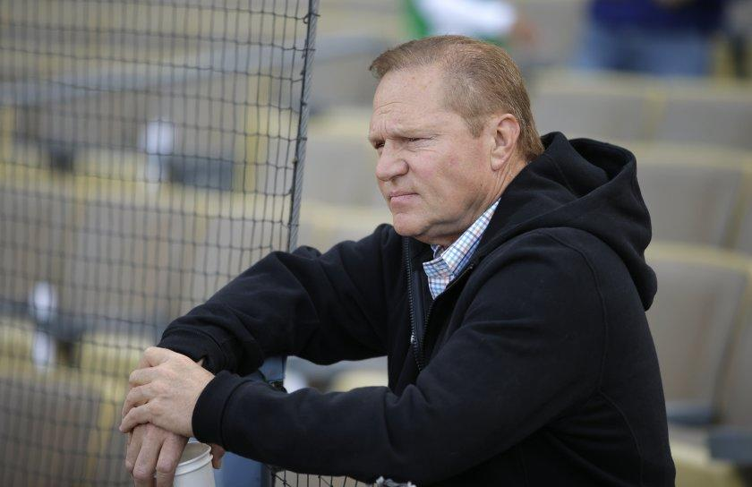 Sports agent Scott Boras watches the Miami Marlins players practice before a baseball game against the Los Angeles Dodgers, Monday, May 11, 2015, in Los Angeles. (AP Photo/Jae C. Hong) ORG XMIT: NYOTK ** Usable by LA and DC Only **