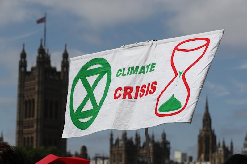 Climate activists gather on the Albert Embankment, adjacent to Lambeth Palace, as they make their way to join the lobby of Parliament on taking action on climate change and environmental protection in Parliament Square, Westminster, London.