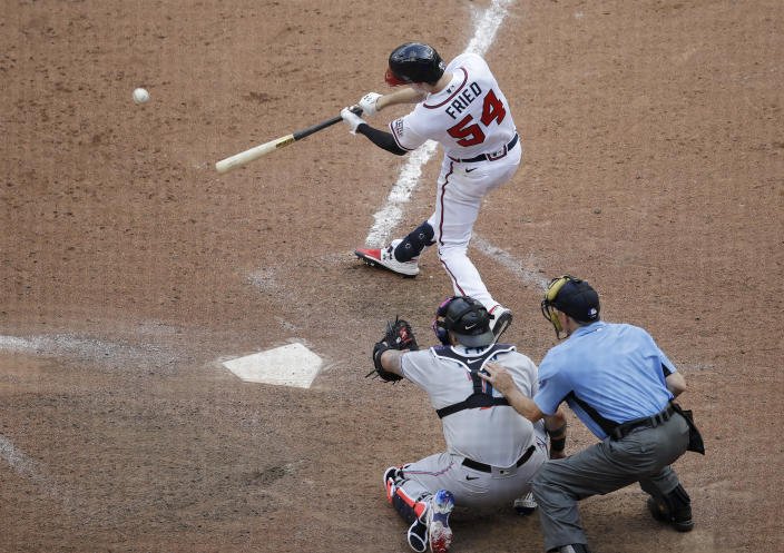 Atlanta Braves' Max Fried swings for the winning hit against the Miami Marlins during the 10th inning of a baseball game Sunday, July 4, 2021, in Atlanta. (AP Photo/Ben Margot)