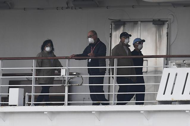 Passengers are seen on the deck of the Diamond Princess. (Getty)