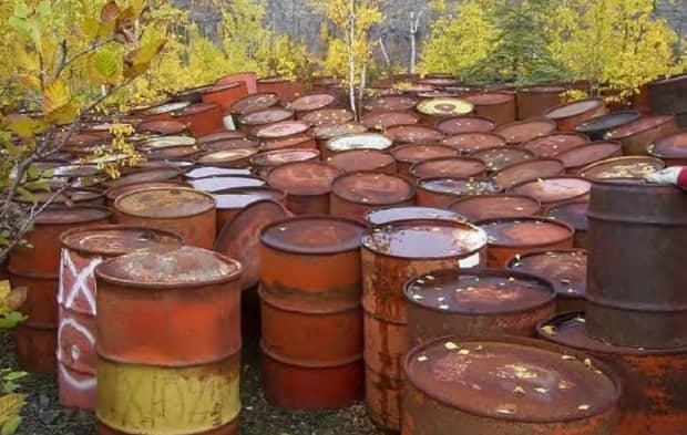 In this file photo, a number of barrels gather rust at the Norex Mine site near Great Bear Lake.