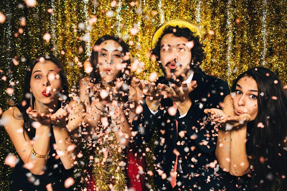 """<p>Celebrate NYE this year with less bitter, more glitter — what's New Year's without a <a href=""""https://www.goodhousekeeping.com/beauty/fashion/g25400387/new-years-eve-outfits/"""" rel=""""nofollow noopener"""" target=""""_blank"""" data-ylk=""""slk:sparkly sequined dress"""" class=""""link rapid-noclick-resp"""">sparkly sequined dress</a>? Encourage your loved ones to wear their most glittery, bedazzled outfits, and don't forget all the <a href=""""https://www.amazon.com/Champagne-Decorations-Streamers-Bachelorette-Engagement/dp/B07RV4H826/ref=sr_1_1?keywords=glitter+decorations&qid=1575392357&sr=8-1&tag=syn-yahoo-20&ascsubtag=%5Bartid%7C10055.g.30105731%5Bsrc%7Cyahoo-us"""" rel=""""nofollow noopener"""" target=""""_blank"""" data-ylk=""""slk:sparkly party streamers"""" class=""""link rapid-noclick-resp"""">sparkly party streamers</a> and <a href=""""https://www.amazon.com/Confetti-Balloons-PREFILLED-Decorations-Proposal/dp/B07NYTDJ9V/ref=sxin_0_ac_d_rm?ac_md=4-4-Z2xpdHRlciBiYWxsb29ucw%3D%3D-ac_d_rm&keywords=glitter+party+decorations&pd_rd_i=B07NYTDJ9V&pd_rd_r=9f374619-1535-4ff0-96d5-c40091c1b151&pd_rd_w=ykb7q&pd_rd_wg=n4mmE&pf_rd_p=6d29ef56-fc35-411a-8a8e-7114f01518f7&pf_rd_r=CN6RM58CEWTG882ADKFA&psc=1&qid=1575392448&tag=syn-yahoo-20&ascsubtag=%5Bartid%7C10055.g.30105731%5Bsrc%7Cyahoo-us"""" rel=""""nofollow noopener"""" target=""""_blank"""" data-ylk=""""slk:glitter-filled balloons"""" class=""""link rapid-noclick-resp"""">glitter-filled balloons</a> so you can bring on the bling in 2021.</p>"""
