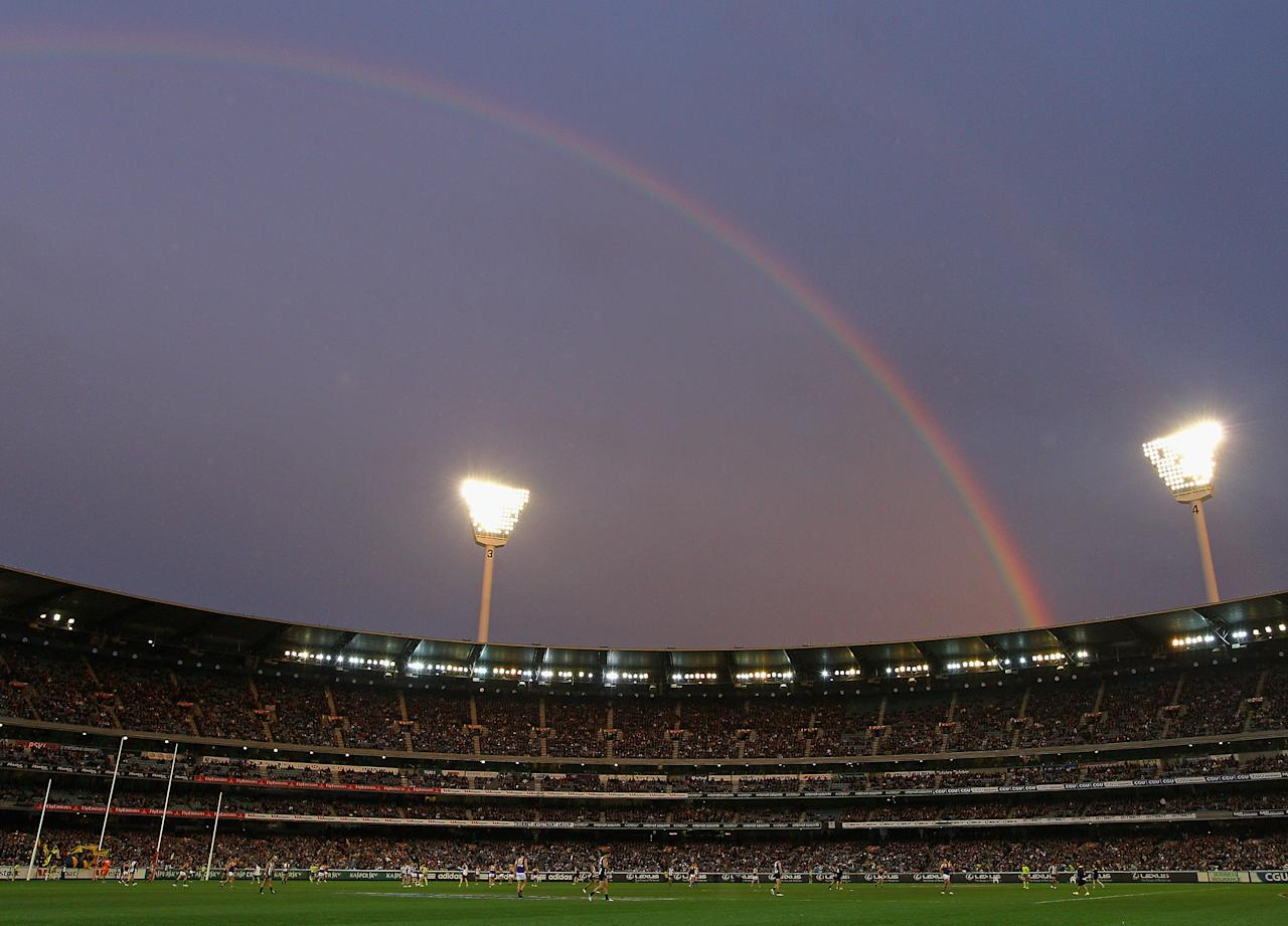 MELBOURNE, AUSTRALIA - JUNE 23:  A rainbow sets over play during the round 13 AFL match between the Collingwood Magpies and the West Coast Eagles at Melbourne Cricket Ground on June 23, 2012 in Melbourne, Australia.  (Photo by Quinn Rooney/Getty Images)