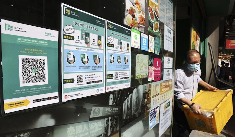 "An eatery displays QR codes for the ""Leave Home Safe"" app. Photo: Nora Tam"