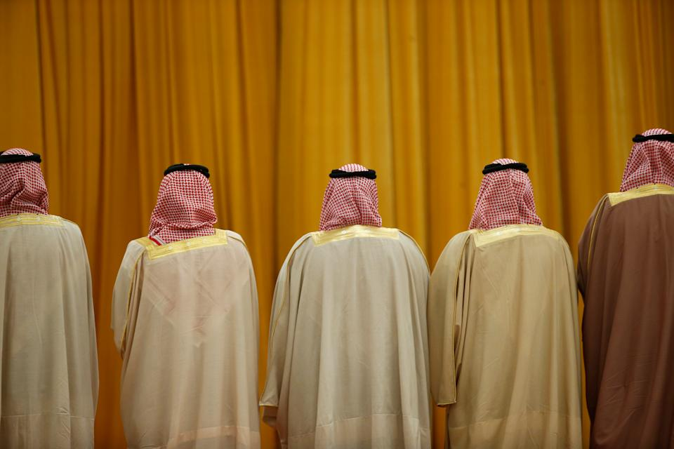 Members of the Saudi delegation wait for the arrival of China's President Xi Jinping and Saudi King Salman bin Abdulaziz Al-Saud before a welcoming ceremony at the Great Hall of the People in Beijing, China, March 16, 2017. REUTERS/Thomas Peter