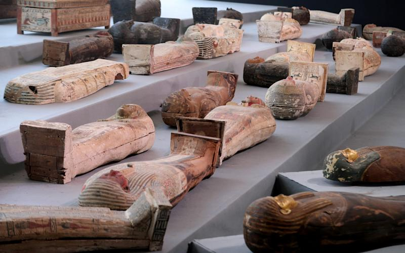 Egypt discovers ancient trove of intact sarcophagi near Cairo
