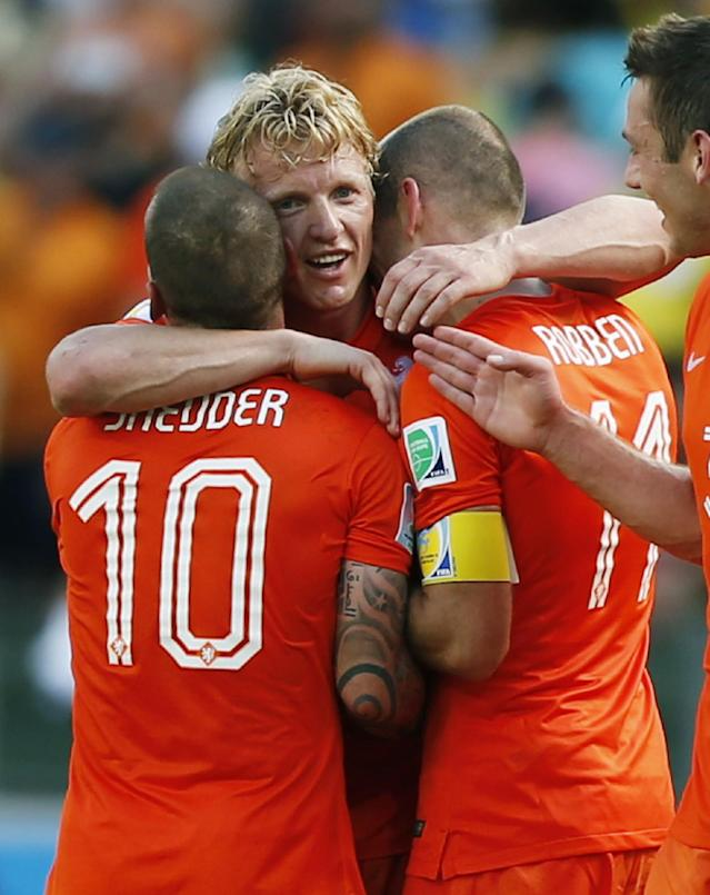Netherlands' Arjen Robben, Dirk Kuyt and Wesley Sneijder celebrate after the World Cup round of 16 soccer match between the Netherlands and Mexico at the Arena Castelao in Fortaleza, Brazil, Sunday, June 29, 2014. The Netherlands won the match 2-1. (AP Photo/Wong Maye-E)