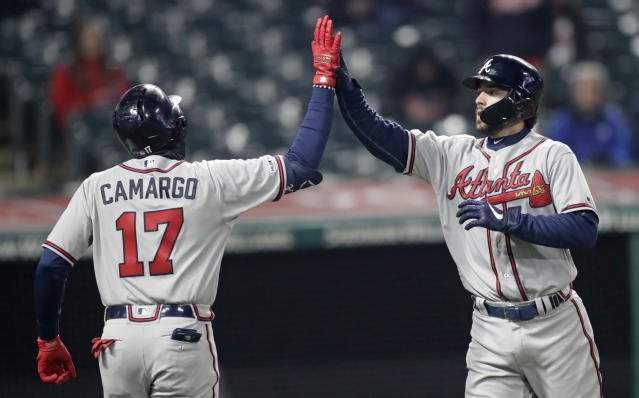 Atlanta Braves' Dansby Swanson, right, is congratulated by Johan Camargo after Swanson hit a two run home run off Cleveland Indians relief pitcher Dan Otero in the seventh inning during the second game of a baseball doubleheader, Saturday, April 20, 2019, in Cleveland. Camargo scored on the play. (AP Photo/Tony Dejak)