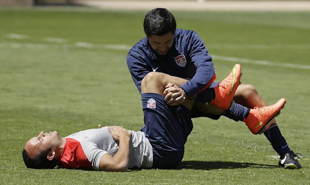 U.S. forward Landon Donovan is assisted in stretching by a trainer during training for the World Cup soccer tournament Thursday, May 22, 2014, in Stanford, Calif. Donovan was cut from the roster later Thursday for the World Cup. (AP Photo/Ben Margot)