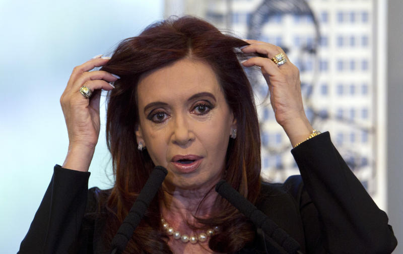 Argentina's President Cristina Fernandez adjusts her hair during her announcement of a bill to nationalize Spain's Repsol controlled oil company YPF, at Government House in Buenos Aires, Argentina, Monday April 16, 2012. Fernandez said in an address to the country that the measure sent to congress on Monday is aimed at recovering the nation's sovereignty over its hydrocarbon resources. (AP Photo/Natacha Pisarenko)