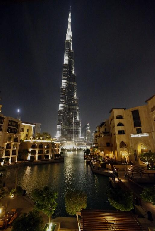"""The lights on the Burj Khalifa tower are seen moments before being switched off for an hour in Downtown Dubai, on March 23, 2013, as iconic landmarks and skylines are plunged into darkness as the """"Earth Hour"""" switch-off of lights around the world got under way to raise awareness of climate change. AFP PHOTO/KARIM SAHIB"""
