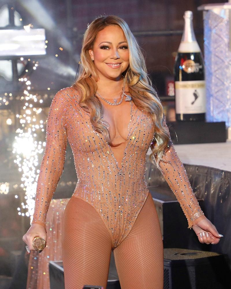 russian billionaire hires elton john and mariah carey to