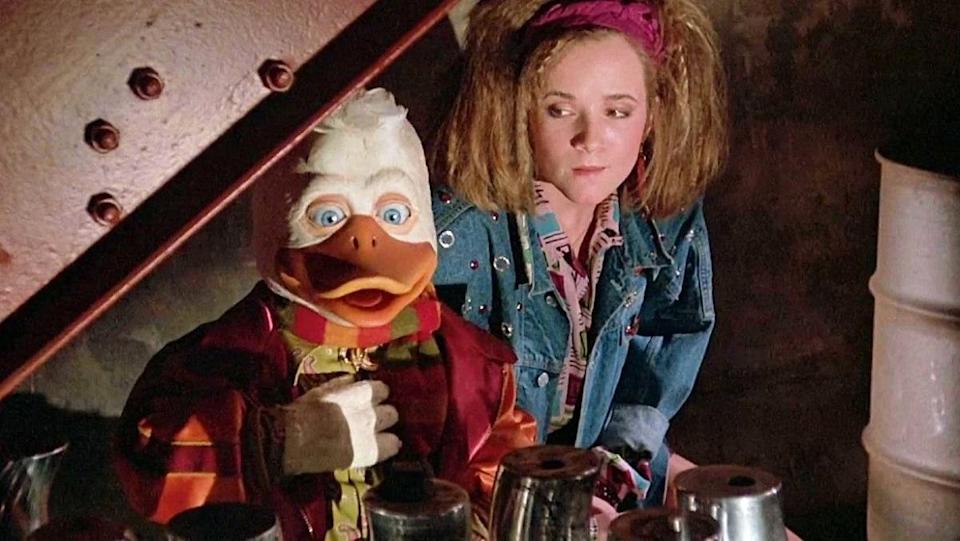 Lea Thompson and the titular Howard the Duck, from the 1986 movie of the same name.