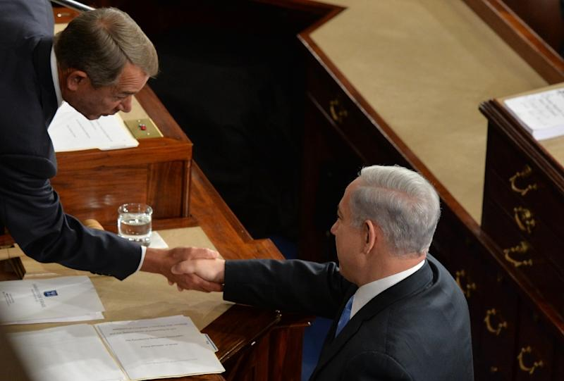 Israeli Prime Minister Benjamin Netanyahu (right) shakes hands with House Speaker John Boehner before he addresses a joint meeting of the US Congress in Washington, DC, on March 3, 2015