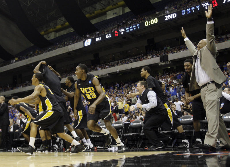 Virginia Commonwealth leaves the bench after winning the Southwest regional final game against Kansas in the NCAA college basketball tournament Sunday, March 27, 2011, in San Antonio. VCU won 71-61. (AP Photo/Eric Gay)