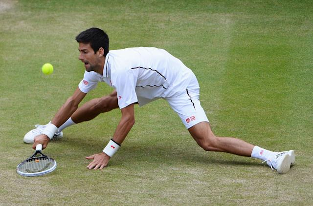 LONDON, ENGLAND - JULY 03: Novak Djokovic of Serbia plays a forehand during the Gentlemen's Singles quarter-final match against Tomas Berdych of Czech Republic on day nine of the Wimbledon Lawn Tennis Championships at the All England Lawn Tennis and Croquet Club at Wimbledon on July 3, 2013 in London, England. (Photo by Mike Hewitt/Getty Images)