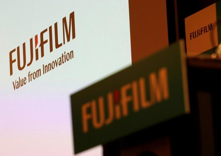 FILE PHOTO: Fujifilm Holdings' logos are pictured ahead of its news conference in Tokyo