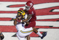 Rutgers' Christian Izien defends against Michigan's Cornelius Johnson during the third overtime of an NCAA college football game Saturday, Nov. 21, 2020, in Piscataway, N.J. Michigan won 48-42. (AP Photo/Frank Franklin II)