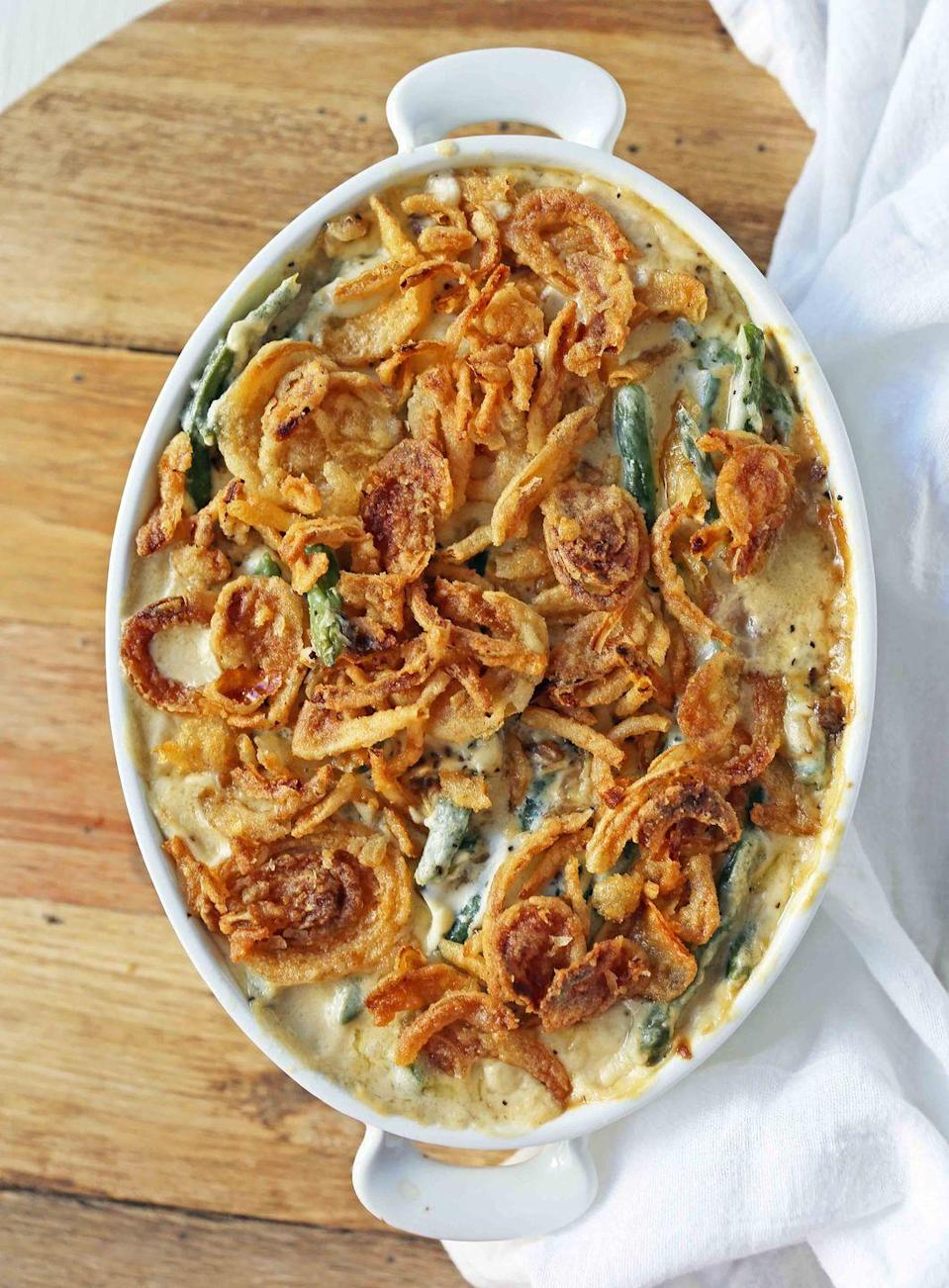 "<p>The beautiful thing about this <a href=""https://www.countryliving.com/food-drinks/g2728/green-bean-casserole-recipe/"" rel=""nofollow noopener"" target=""_blank"" data-ylk=""slk:green bean casserole"" class=""link rapid-noclick-resp"">green bean casserole</a> is that it can be adapted depending on what you have on hand. Fresh, frozen, or canned green beans will all work in this recipe.</p><p><strong>Get the recipe at <a href=""https://www.modernhoney.com/homemade-green-bean-casserole/"" rel=""nofollow noopener"" target=""_blank"" data-ylk=""slk:Modern Honey"" class=""link rapid-noclick-resp"">Modern Honey</a>.</strong></p><p><strong><a class=""link rapid-noclick-resp"" href=""https://www.amazon.com/dp/B074Z5X8MT/?tag=syn-yahoo-20&ascsubtag=%5Bartid%7C10050.g.34554232%5Bsrc%7Cyahoo-us"" rel=""nofollow noopener"" target=""_blank"" data-ylk=""slk:SHOP BAKING DISHES"">SHOP BAKING DISHES</a><br></strong></p>"