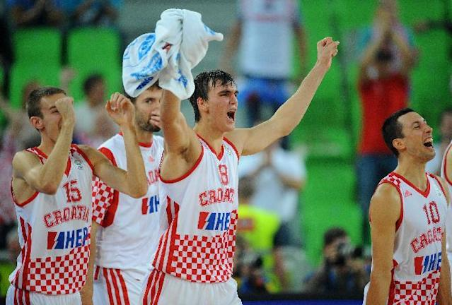 Dario Saric of Croatia (C) and his teammates celebrate their victory after the FIBA Eurobasket quarter final against Ukraine at the Stozice Arena in Ljubljana, on September 19, 2013 (AFP Photo/Andrej Isakovic)