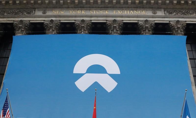Chinese electric vehicle start-up NIO Inc. logo is on display in front of the NYSE to celebrate the company's IPO in New York