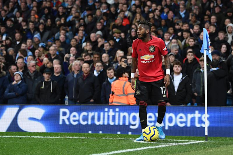 MANCHESTER, ENGLAND - DECEMBER 07: Fred of Manchester United takes a corner kick after being hit by objects thrown by the Manchester City fans during the Premier League match between Manchester City and Manchester United at Etihad Stadium on December 07, 2019 in Manchester, United Kingdom. (Photo by Laurence Griffiths/Getty Images)