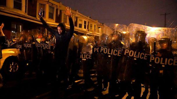 PHOTO: Sharif Proctor lifts his hands up in front of the police line during a protest in response to the police shooting of Walter Wallace Jr., Oct. 26, 2020, in Philadelphia. (Jessica Griffin/The Philadelphia Inquirer via AP)