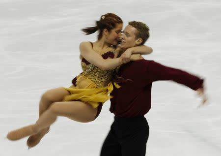 Emily Samuelson (L) and Evan Bates of the U.S. perform in the ice dance free dance figure skating event at the Vancouver Winter Olympics February 22, 2010.   REUTERS/Gary Hershorn/File Photo