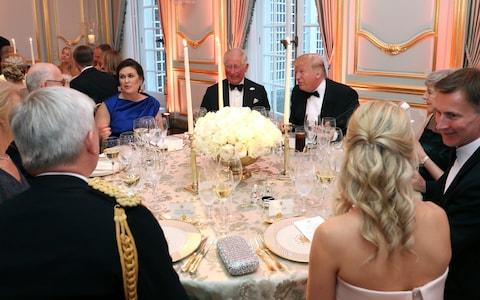 US President Donald Trump (R) and First Lady Melania Trump host a dinner at Winfield House for Prince Charles, Prince of Wales (C) and Camilla, Duchess of Cornwall, with White House Press Secretary Sarah Sanders (L) - Credit: Chris Jackson - WPA Pool/Getty Images