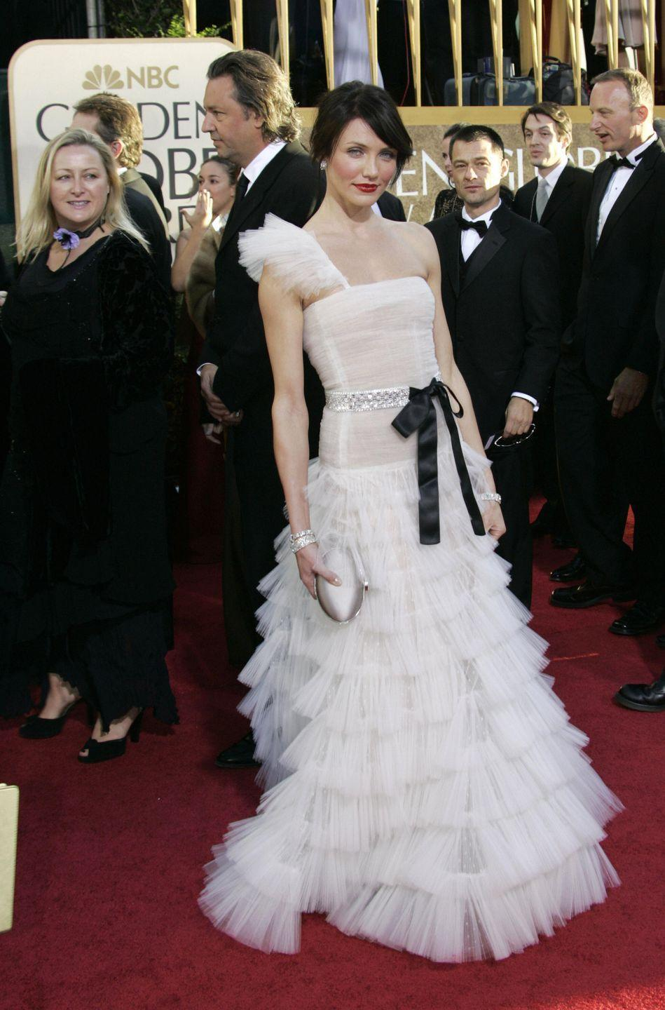 <p>Remember this brunette phase in 2007? Diaz ditched her signature blonde locks that year, attending the Globes in a tiered Valentino gown with a ribbon at the waist. </p>