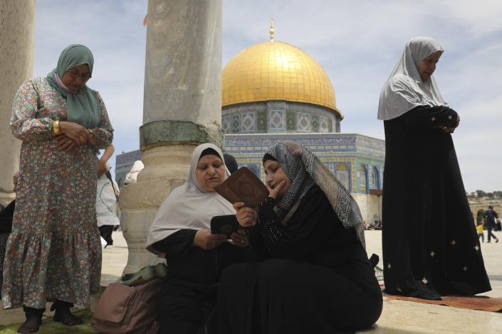 Palestinian women take part in the last Friday prayers of the Muslim holy month of Ramadan at the Dome of the Rock Mosque in the Al Aqsa Mosque compound in the Old City of Jerusalem, Jerusalem, Friday, May 7, 2021. (AP Photo/Mahmoud Illean)