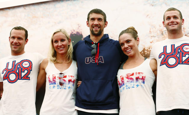 Jul 25, 2012; London, United Kingdom; USA swimmers Brendan Hensen and Jessica Hardy and Michael Phelps and Natalie Coughlin and Tyler Clary pose for a photograph during a press conference at Speedo Club at Forman's Fish Island. Mandatory Credit: Rob Schumacher-USA TODAY Sports