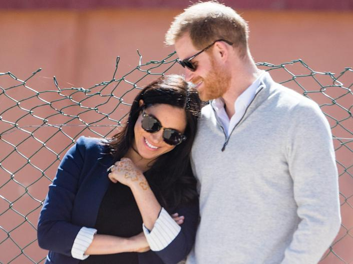 Prince Harry and Meghan Markle lean into each other in Morocco.
