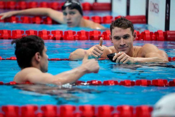 PHOTO: The United States' Ryan Murphy gives a thumbs up to Evgeny Rylov, of Russian Olympic Committee, after Rylov won the men's 200-meter backstroke final at the 2020 Summer Olympics, Friday, July 30, 2021, in Tokyo, Japan. (David Goldman/AP Photo)