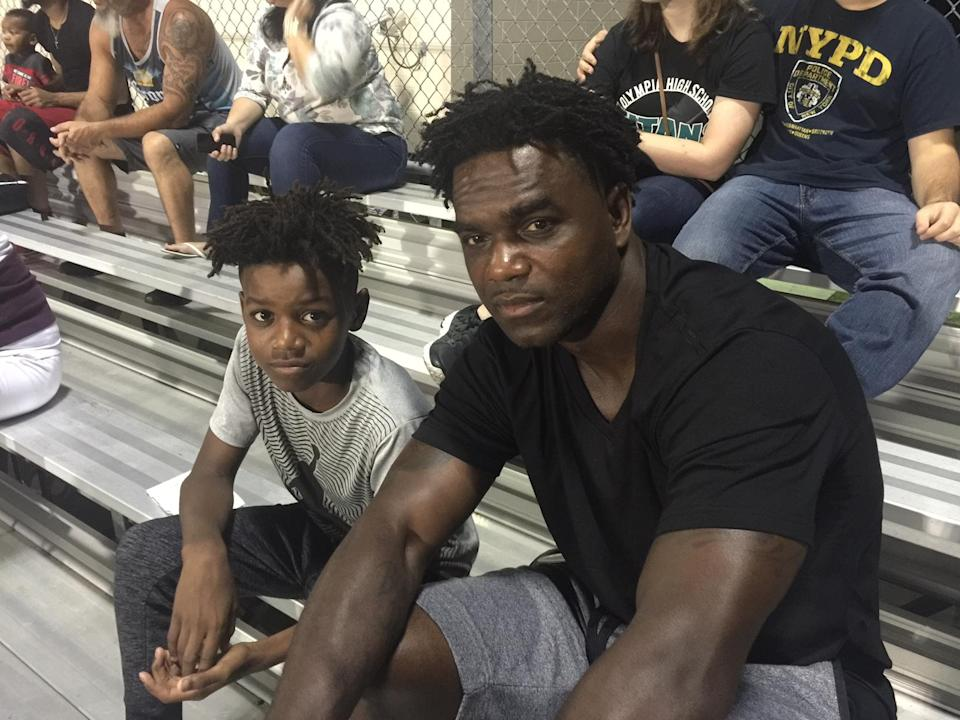 Edgerrin James, pictured with his son Edgerrin Jr., has helped his hometown recover from a natural disaster. (Yahoo Sports)