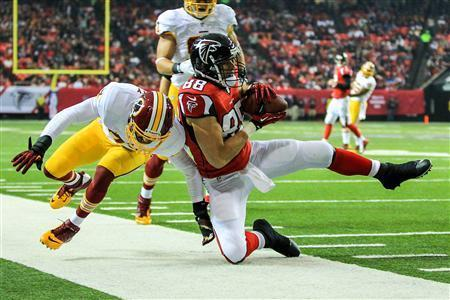 Atlanta Falcons tight end Tony Gonzalez (88) is tackled after a catch by Washington Redskins strong safety Reed Doughty (37) in the first half at the Georgia Dome. Daniel Shirey-USA TODAY Sports