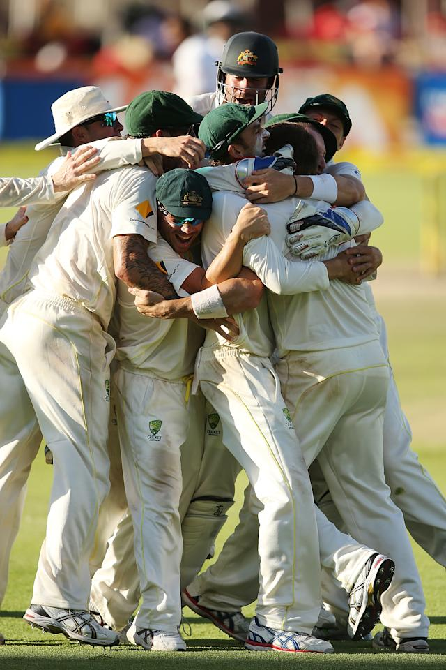 CAPE TOWN, SOUTH AFRICA - MARCH 05: Australian players celebrate after winning the game during day 5 of the third test match between South Africa and Australia at Sahara Park Newlands on March 5, 2014 in Cape Town, South Africa.  (Photo by Morne de Klerk/Getty Images)