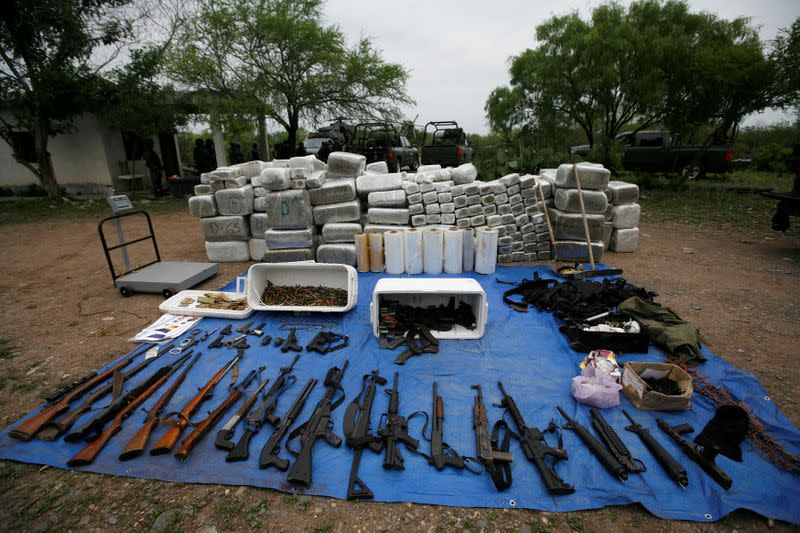 FILE PHOTO: Packs of marijuana, weapons and other scales are displayed after an operation against drug hitmen by Mexican soldiers at a ranch near the municipality of Sabinas Hidalgo