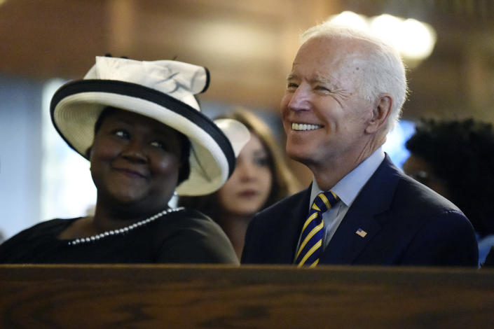 FILE - In this July 7, 2019, file photo, Democratic presidential candidate and former Vice President Joe Biden attends a Sunday service at Morris Brown AME Church in Charleston, S.C. Democrats are betting on Biden's evident comfort with faith as a powerful point of contrast in his battle against President Donald Trump.(AP Photo/Meg Kinnard, File)