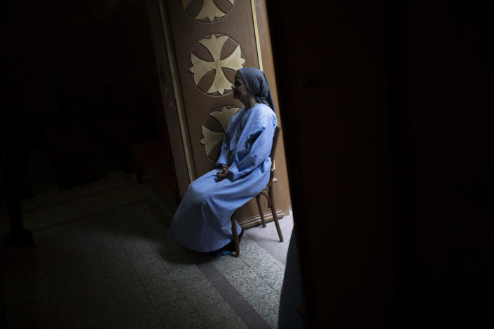 A Coptic nun attends prayer at a church within Al-Mahraq monastery in Assiut, Upper Egypt, Tuesday, Aug. 6, 2013. Islamists may be on the defensive in Cairo, but in Egypt's deep south they still have much sway and audacity: over the past week, they have stepped up a hate campaign against the area's Christians. Blaming the broader Coptic community for the July 3 coup that removed Islamist president Mohammed Morsi, Islamists have marked Christian homes, stores and churches with crosses and threatening graffiti. (AP Photo/Manu Brabo)
