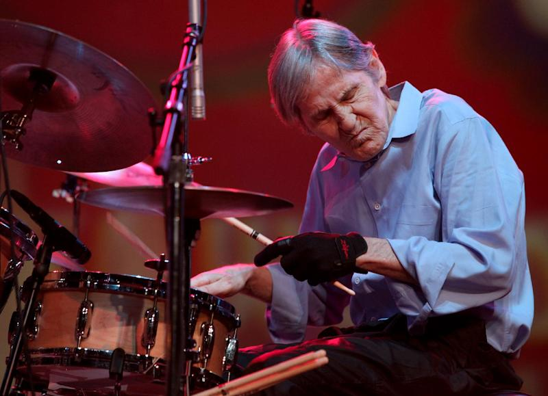 "FILE - In this Aug. 14, 2009 file photo, Levon Helm performs with the Levon Helm band during the Heroes of Woodstock concert at Bethel Woods Center for the Arts in Bethel, N.Y. Elton John and Mumford & Sons will hit the Grammys stage to pay tribute to Levon Helm. The Recording Academy announced Thursday that T Bone Burnett, Mavis Staples, Zac Brown and Brittany Howard of Alabama Shakes will also perform ""The Weight"" at Sunday's awards ceremony in Los Angeles. (AP Photo/Craig Ruttle, File)"