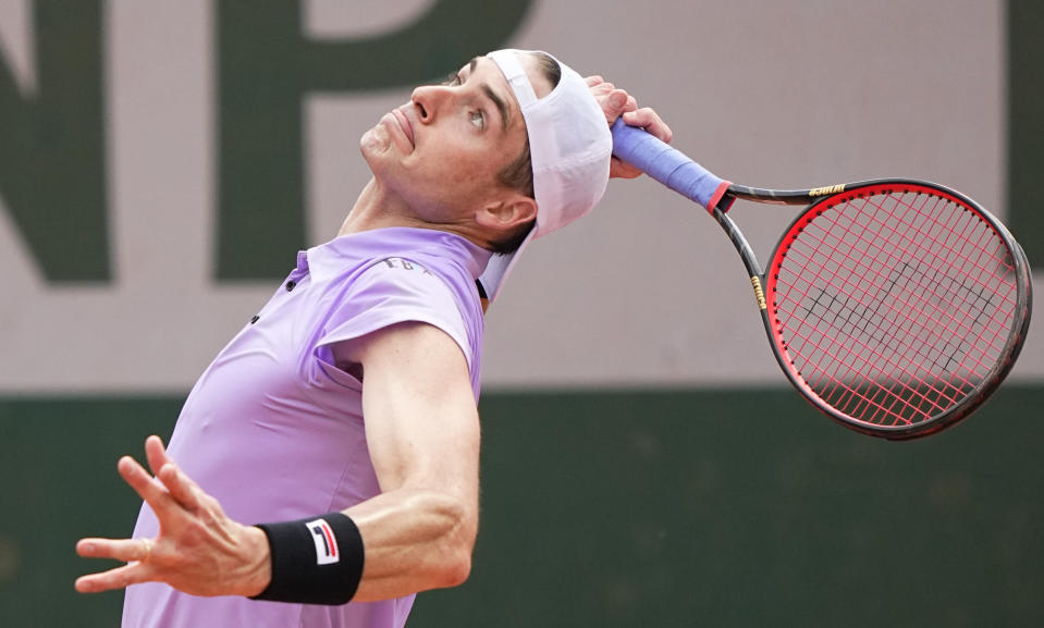United States' John Isner serves to Serbia's Filip Krajinovic during their second round match on day four of the French Open tennis tournament at Roland Garros in Paris, France, Wednesday, June 2, 2021. (AP Photo/Michel Euler)