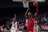 Arizona forward Jordan Brown (21) scores over Southern California forward Isaiah Mobley (3) during the first half of an NCAA college basketball game Saturday, Feb. 20, 2021, in Los Angeles. (AP Photo/Marcio Jose Sanchez)