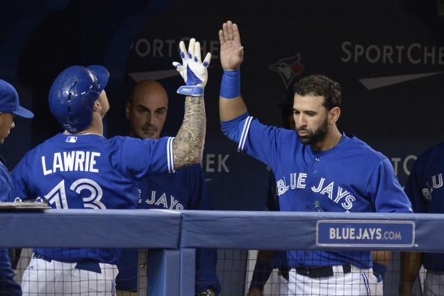 Toronto Blue Jays' Jose Bautista, right, congratulates Brett Lawrie on his solo home run against the Boston Red Sox during second-inning baseball game action in Toronto, Sunday, April 27, 2014. (AP Photo/The Canadian Press, Frank Gunn)