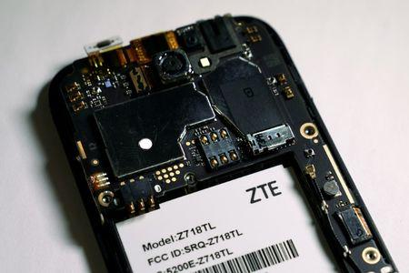 FILE PHOTO: The inside of a ZTE smart phone is pictured in this illustration taken April 17, 2018. REUTERS/Carlo Allegri/Illustration/File Photo