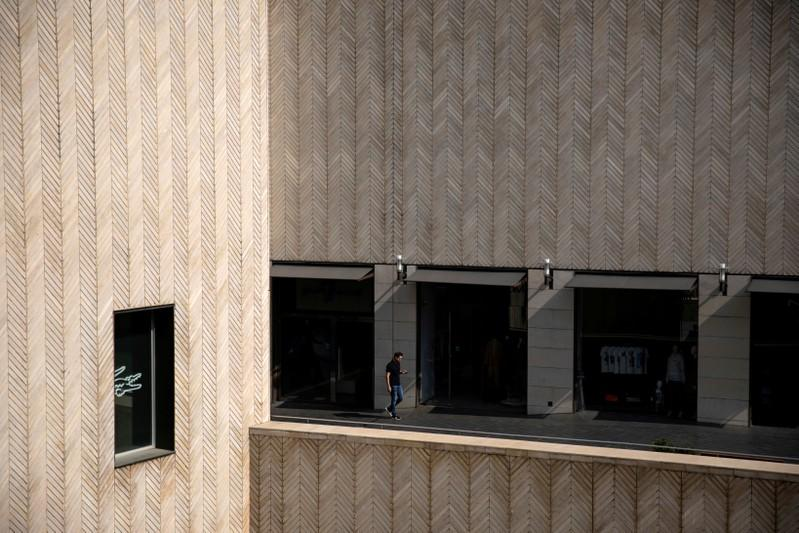 FILE PHOTO: A man walks next to closed shops at a mall in downtown Beirut