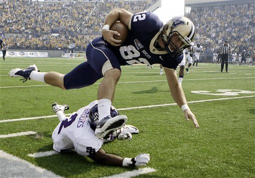 Montana State wide receiver Jake Olson goes airborne over Stephen F. Austin's Mike Brooks during their NCAA college football game on Saturday, Sept. 15, 2012, in Bozeman, Mont. Montana State defeated Stephen F. Austin 43-35. (AP Photo/Bozeman Daily Chronicle, Adrian Sanchez-Gonzalez)