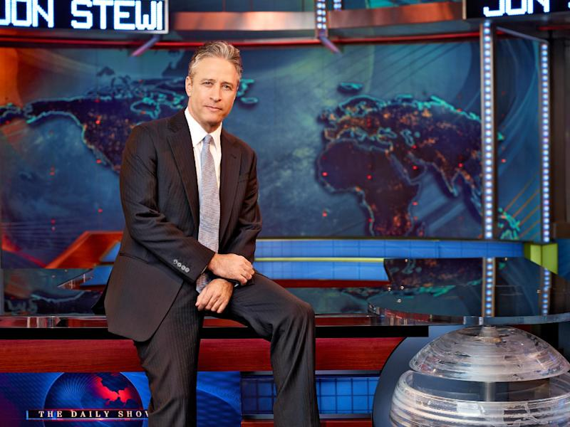 "This undated image released by Comedy Central shows Jon Stewart on the set of ""The Daily Show with Jon Stewart"" in New York. The Comedy Central show is decamping for both the Republican and Democrat conventions to broadcast a week of shows at each that will parody the nation's most extravagant political pageants. (AP Photo/Comedy Central, Martin Crook)"