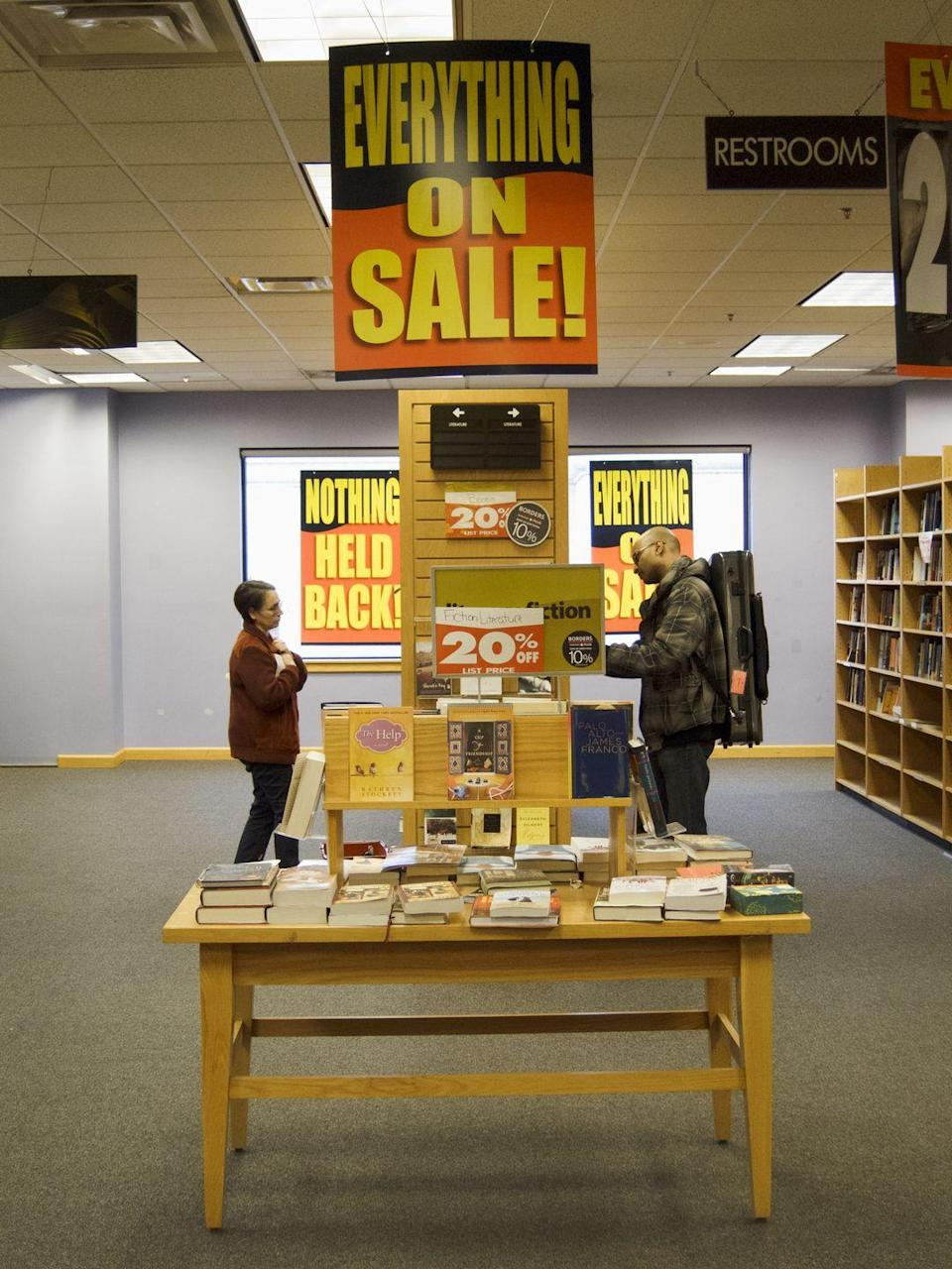 """<p>Behold: the bleakest, most cursed image you've ever seen. Why must the """"EVERYTHING ON SALE!"""" signs be in those terrible colors?! </p>"""