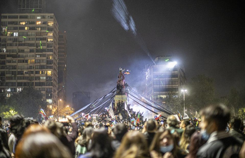 """<span class=""""caption"""">Chileans celebrate victory after the referendum, in Santiago, Chile, Oct. 25, 2020.</span> <span class=""""attribution""""><a class=""""link rapid-noclick-resp"""" href=""""https://www.gettyimages.com/detail/news-photo/people-gather-to-celebrate-the-victory-of-the-referendum-in-news-photo/1229286678?adppopup=true"""" rel=""""nofollow noopener"""" target=""""_blank"""" data-ylk=""""slk:Felipe Vargas Figueroa/NurPhoto via Getty Images"""">Felipe Vargas Figueroa/NurPhoto via Getty Images</a></span>"""